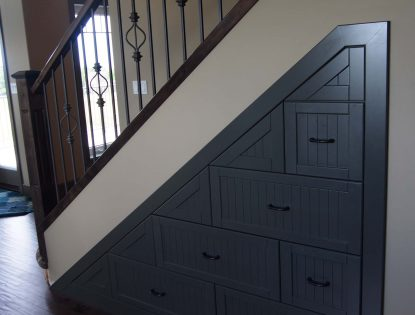 Under the stairs cabinetry by Hiebert Cabinets in Bow Island, Alberta.. Other | Painted | Flat Panel