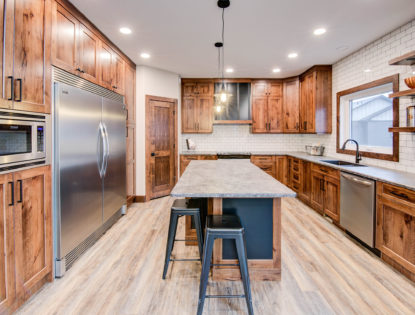 Custom kitchen cabinets by Hiebert Cabinets in Bow Island, Alberta.. Kitchen | Hickory | Painted | Islands | Contemporary | Flat Panel | Rustic