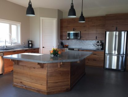 Custom Kitchen Island and Cabinetry Featuring a rustic walnut slab kitchen by Hiebert Cabinets in Bow Island, Alberta.. Kitchen | Walnut | Islands | Traditional | Contemporary