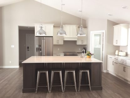 Two-toned kitchen island by Hiebert Cabinets in Bow Island, Alberta.. Kitchen | Painted | Hickory | Flat Panel | Contemporary
