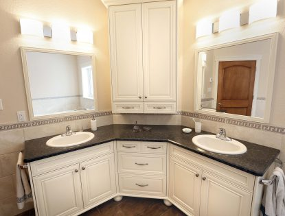 Custom bathroom vanity & mirrors by Hiebert Cabinets in Bow Island, Alberta.. Bathroom | Painted | Mitered Doors | Unique Feature | Traditional