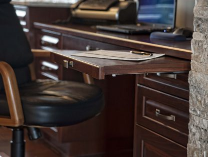 Custom desk with writing pullout by Hiebert Cabinets in Bow Island, Alberta.. Office | Beech | Unique Feature