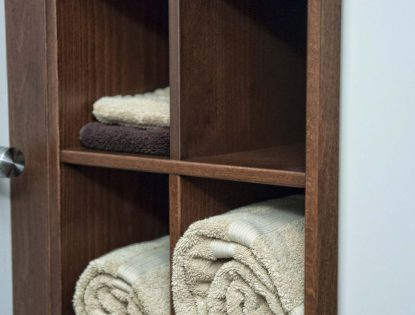 Towel storage cabinetry by Hiebert Cabinets in Bow Island, Alberta.. Bathroom | Hard Maple | Unique Feature