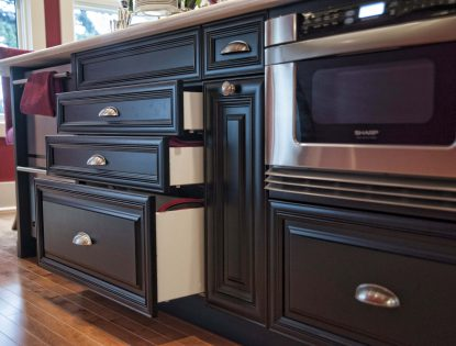 Microwave in island and custom kitchen cabinetry by Hiebert Cabinets in Bow Island, Alberta.. Kitchen | Painted | Raised Panel | Mitered Doors | Traditional | Islands