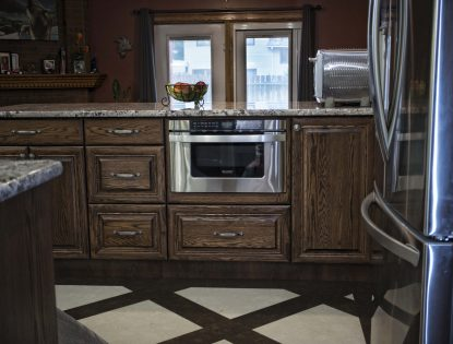 Microwave in island by Hiebert Cabinets in Bow Island, Alberta.. Kitchen | Raised Panel | Traditional | Mitered Doors | Islands