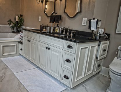 Applied moulding by Hiebert Cabinets in Bow Island, Alberta.. Bathroom | Painted | Traditional | Mitered Doors | Unique Feature