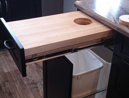 Cutting board & garbage pullout by Hiebert Cabinets in Bow Island, Alberta.. Accessories | Hard Maple | Unique Feature