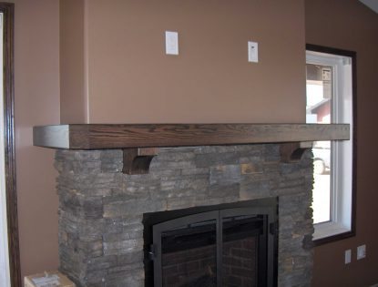 Wrap around mantle by Hiebert Cabinets in Bow Island, Alberta.. Fireplace | Oak | Contemporary