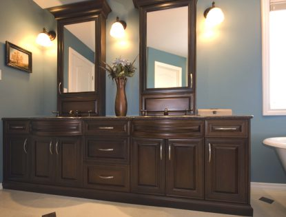 Curved sink panels by Hiebert Cabinets in Bow Island, Alberta.. Bathroom | Hard Maple | Mitered Doors | Traditional | Unique Feature