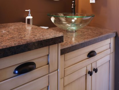 Custom vanity cabinetry with cup pulls by Hiebert Cabinets in Bow Island, Alberta.. Bathroom | Painted | Dusted | Flat Panel