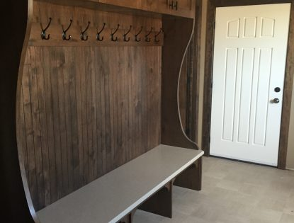 Custom boot room entryway storage and coat hangers by Hiebert Cabinets in Bow Island, Alberta.. Lockers | Alder | Flat Panel | Rustic | Unique Feature