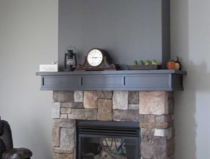 Wrap around, grey stained mantle by Hiebert Cabinets in Bow Island, Alberta.. Fireplace | Contemporary