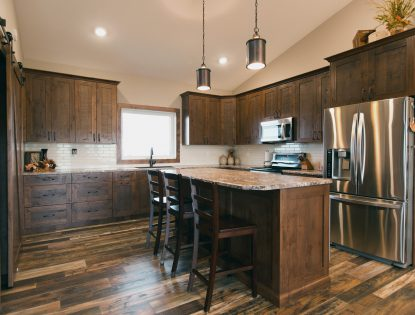 Custom rustic kitchen cabinetry with island by Hiebert Cabinets in Bow Island, Alberta.. Kitchen | Alder | Rustic | Flat Panel