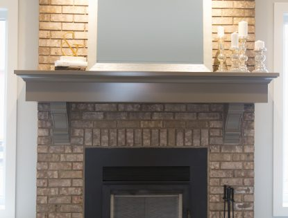 Custom modern mantle by Hiebert Cabinets in Bow Island, Alberta.. Fireplace | Painted | Contemporary
