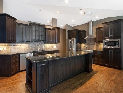 Stepped cabinetry, Dark Stain by Hiebert Cabinets in Bow Island, Alberta.. Kitchen | Alder | Raised Panel | Islands