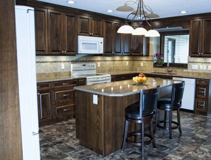 Dark stained to the ceiling cabinets by Hiebert Cabinets in Bow Island, Alberta.. Kitchen | Beech | Raised Panel | Traditional | Islands