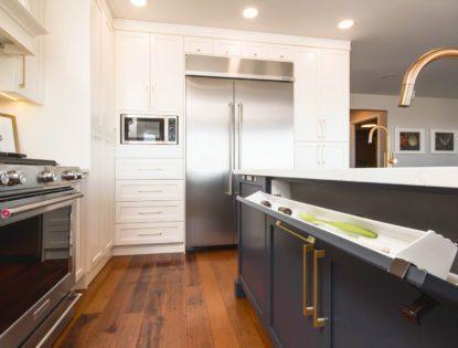 Dark painted cabinets under an kitchen island sink. Accessories | Kitchen | Painted | Flat Panel | Islands