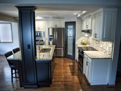 Featuring white & dark brown stain, floor to ceiling cabinetry with ORB handles. Kitchen | Painted | Hard Maple | Raised Panel | Islands | Mitered Doors | Traditional