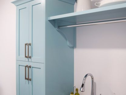 Custom laundry room cabinetry with drying rod. Laundry | Painted | Flat Panel | Contemporary