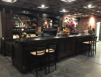 Custom brewery bar featuring dark oak. Other | Oak | Flat Panel | Traditional | Mitered Doors
