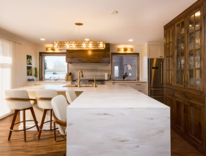 Kitchen with a modern island in Medicine Hat, Alberta. Kitchen | Hickory | Painted | Islands