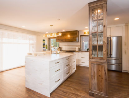 Kitchen island with hickory painted, flat-panel cabinets in Medicine Hat, Alberta. Kitchen | Hickory | Painted | Islands | Flat Panel | Unique Feature
