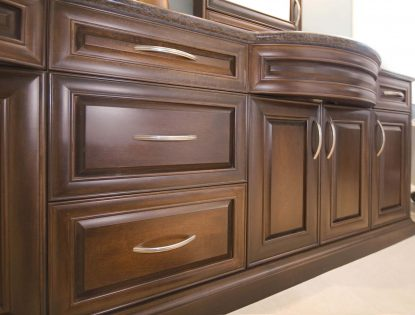 Stained, curved panels. Bathroom | Hard Maple | Mitered Doors | Raised Panel | Traditional | Unique Feature