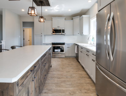 Kitchen cabinets with and island by Hiebert Cabinets in Bow Island, Alberta.. Kitchen | Islands